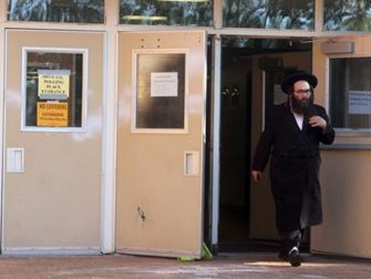 A voter leaves Spring Valley High School after voting