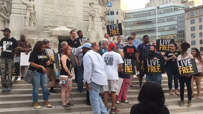 Protesters gather on Monument Circle Friday to call for reforms after a police merit board cleared two IMPD officers in the 2017 shooting of unarmed motorist Aaron Bailey.