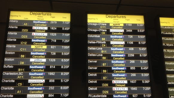 A flight departure board at Baltimore/Washington International