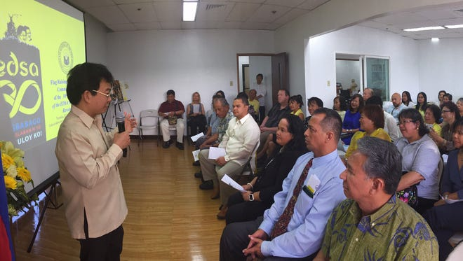 Consul General Marciano R. de Borja delivers his message on the 30th anniversary of the EDSA People Power Revolution. In front are Consul Mark Francis C. Hamoy, Senators Tom Ada, Frank B. Aguon Jr., Tina Muña Barnes, Dennis G. Rodriguez Jr., and Consuls General Robert Ruecho of Micronesia and Vic April of Palau.