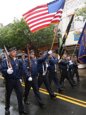 The color guard of the Charles R. and Raymond O. Blauvelt American Legion Post 310, Nyack, marches on Main Street in the Nyack Memorial Day parade May 29, 2017.