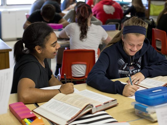 Sophomores Kourtney Thomason and Nicole Mallory work together during an AP U.S. Government class Thursday, September 24, 2015 at Port Huron High School.