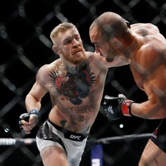 Nov 12, 2016; New York, NY, USA;  Conor McGregor (blue gloves) fights Eddie Alvarez (red gloves) in their lightweight title bout during UFC 205 at Madison Square Garden. Mandatory Credit: Adam Hunger-USA TODAY Sports