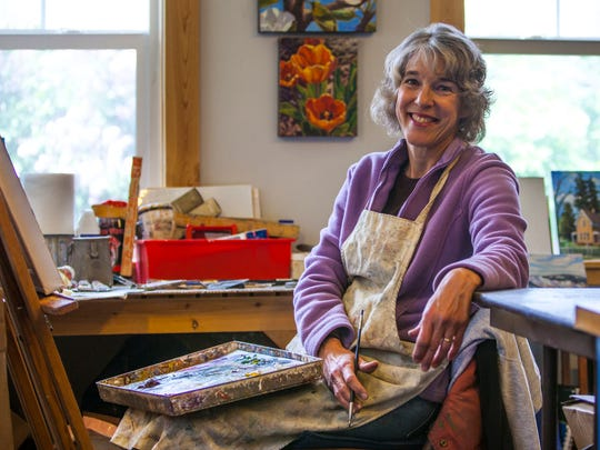 Artist Valerie Orlemann poses for a photo in her home studio, Friday, May 6, 2016.