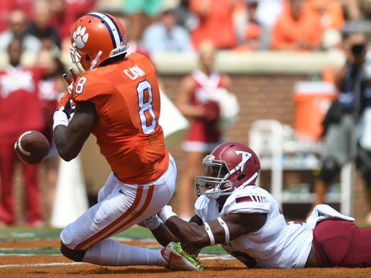 Clemson wide receiver Deon Cain (8) drops a pass in the end zone in the first quarter Saturday at Memorial Stadium.