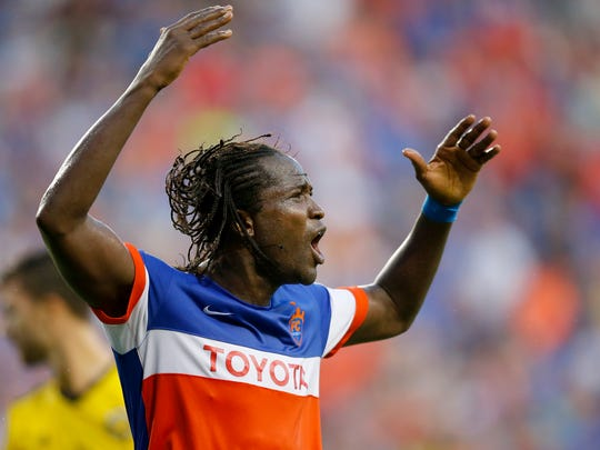 FC Cincinnati's Djiby Fall (9) pumps up the fans between