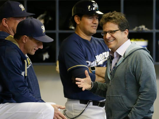 Brewers owner Mark Attanasio, right, shares a laugh with manager Craig Counsell before a game in 2016. Attanasio delivered his annual spring training address to the team on Tuesday morning.
