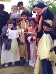 Mary and Joseph, portrayed by children, are welcomed
