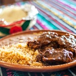 The Mole Rojo Combo served at Tacos Mexicanos on Palm Bay Road in Palm Bay consists of chicken smothered in red mole sauce, rice, beans and your choice of tortilla.