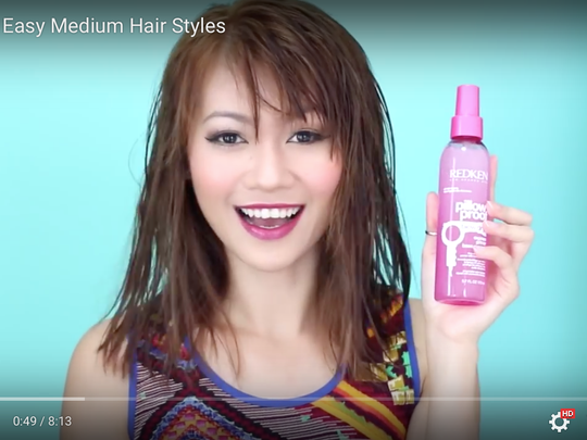 K.L Cao plugs hair products in her hair care video