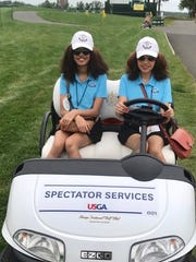 Victoria and Katie Wilson on the course serving as