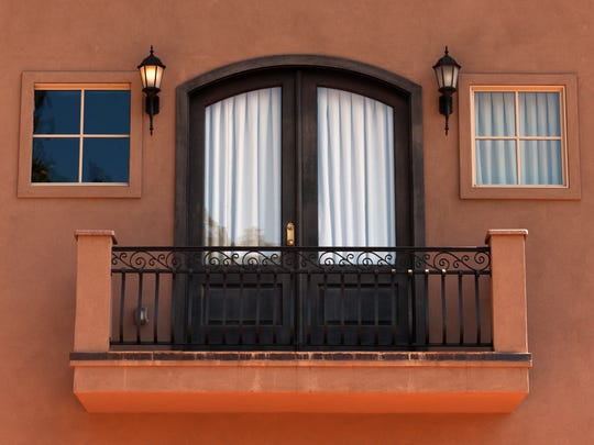 Iron balcony railings add a touch of elegance to a