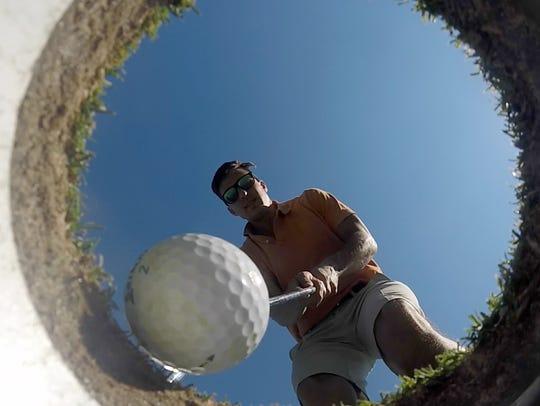 Vincent Mercogliano knocks in a putt at Saxon Woods