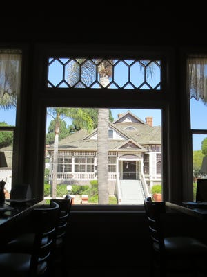 The main dining room at La Dolce Vita Ristorante in Oxnard offers views of other historic homes that were moved to Heritage Square more than 25 years ago.