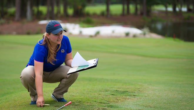 United States Golf Association Championship Director Rachel Sadowski inspects the rough along a putting green at Quail Creek Country Club in North Naples on Thursday, Oct. 6, 2016.  Preparations have begun for the country club to host the 2017 U.S. Women's Mid-Amateur in October 2017.