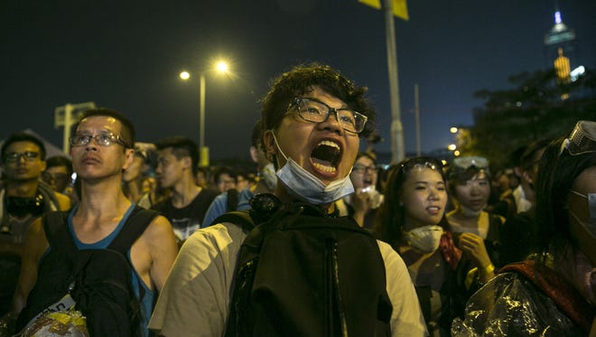A pro-democracy protester in Hong Kong stands outside the legislative government complex Oct. 2. Thousands of supporters  occupied the streets of the city's  financial district.
