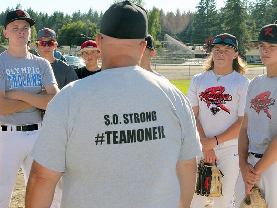 Steve Dickey, coach of the Renegades, wears a #TeamONeill shirt at a recent practice. The shirt memorializes Sean O'Neil, father of player Logan O'Neil, who died recently of cancer.