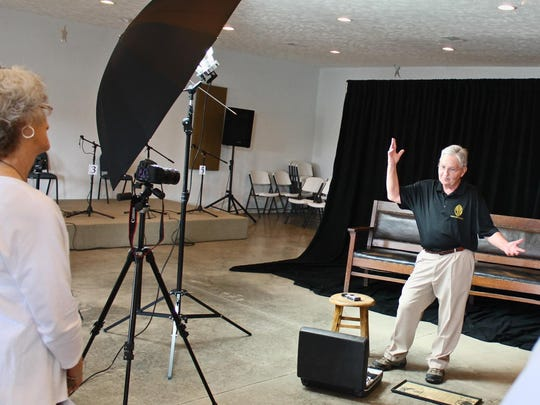 Charlie Todd, whose grandfather was the team coach, begins the taping by explaining to the family members what they're going to achieve with the interviews and photos for the book and videotape.