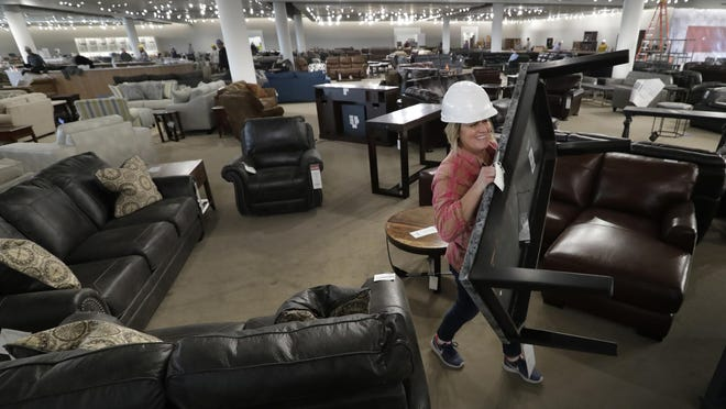 Assistant buyer Jenny Gagan sets up furniture vignettes at the new WG&R store in Grand Chute, Wisconsin. Furniture shopping may be the last thing you want to do, but it may be necessary if you moved into a bigger space or parted with unwanted goods in that process.