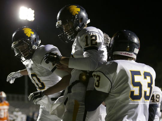 Wausau West's Brady Lenz, right, celebrates a touchdown against Appleton West with teammates Chandler Fochs (12) and Sam Paoli.