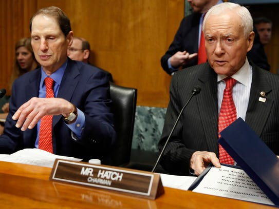 Senate Finance ranking member Ron Wyden, D-Ore., left,