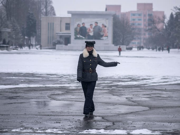 A security guard stands in a courtyard of the Kim Jong-Suk