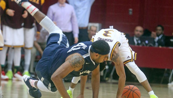 Monmouth's Chris Brady tumbles over Iona's Ibn Muhammad as they scramble for a loose ball during a MAAC conference game at Iona College Jan. 15, 2016.