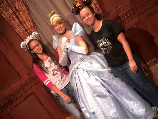 Maya, left, and Alexis Elcox with Cinderella at Walt