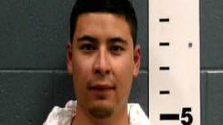 A photo provided by the Las Cruces Police Department shows  deputy Tai Chan.
