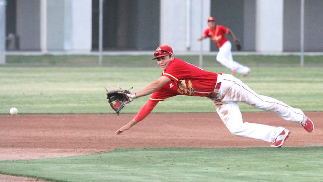 Palm Desert's third baseman Nate Lopez tries to field a ground ball during the game against Shadow Hills at Palm Desert High School on Tuesday, March 15, 2016.