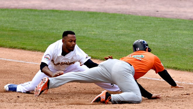 York's Alonzo Harris moves to tag out Long Island's Dan Lyons at first during Atlantic League baseball action and Baseball in Education Day at PeoplesBank Park in York City,  Wednesday, May 3, 2017. The Revs lost the game, 7-2, and then went on to lose the second game of the day, 8-5, completing a four-game sweep for Long Island. Dawn J. Sagert photo