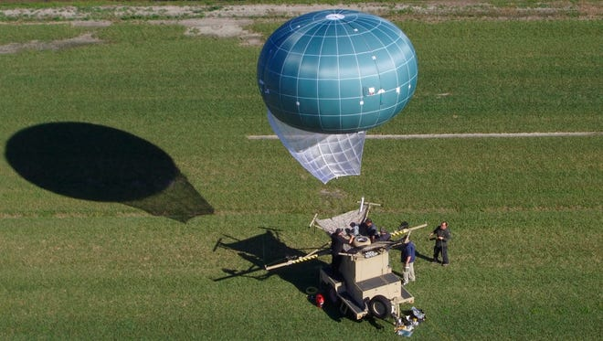This undated aerial photo provided by Drone Aviation Corp. shows a tethered balloon, called Winch Aerostat Small Platform, or WASP.  The U.S. Border Patrol is considering another type of surveillance balloon to spot illegal activity.