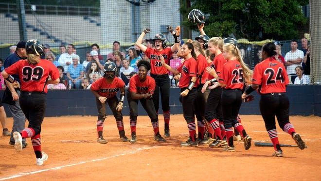 The West Florida Softball team gathers at the plate to welcome Mackenzee McBride after her grand slam home run against Gulf Breeze during the Region 1-6A semifinals on May 8.