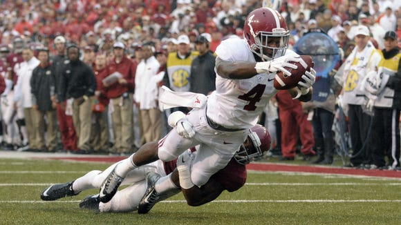 Alabama's T.J. Yeldon scores at the end of a 22-yard reception in the second quarter last week against Arkansas. Yeldon was limited to 45 yards on 16 rushes, however, as the Crimson Tide running game couldn?t get untracked. Alabama running back T.J. Yeldon (4) dives into the end zone after a 22-yard reception for a touchdown as he is tackled by Arkansas cornerback Jared Collins in the 2nd quarter of an NCAA college football game in Fayetteville, Ark., Saturday, Oct. 11, 2014. (AP Photo/David Quinn)