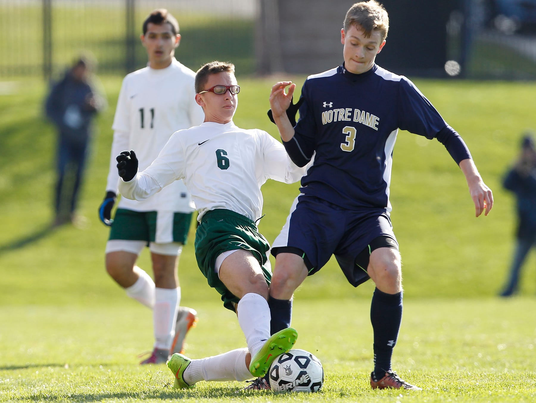 Solomon Schechter's Ben Levin (6) puts a tackle on Alec Cutler (3) during their 9-1 loss to Notre Dame in the NYSPHSAA boys class C soccer final at Middletown High School on Sunday, Nov. 15, 2015.