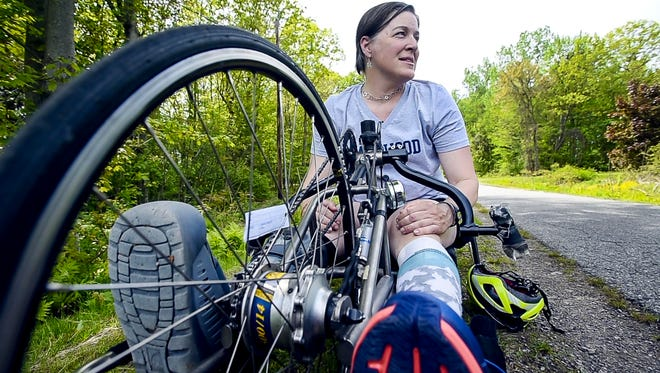 Kirsten Berggren, a Nordic ski coach at Burlington High School, decided to do the handcycle portion of the Vermont City Marathon after surgery to fix an ankle injury she suffered years ago.  Seen on the Burlington bike path on Wednesday, May 23, 2017.
