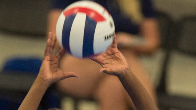 North All-Star's Yta'e Cobb sets the ball during the AHSAA All-Star Volleyball game on Thursday, July 23, 2015, in Montgomery, Ala.
