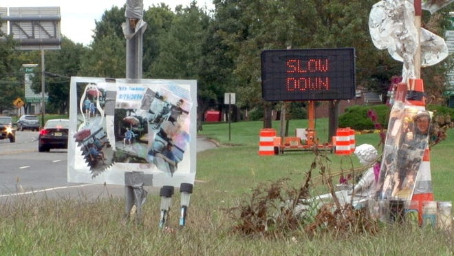 A roadside memorial at the site of a fatal car accident. A sign along Kosloski Road in Freehold, reminds drivers to slow down and drive the speed limit.