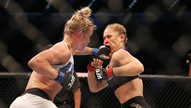 Holly Holm strikes Ronda Rousey at UFC 193.