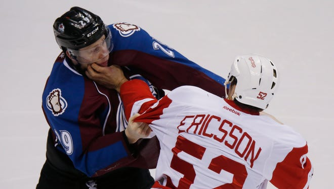 Detroit Red Wings defenseman Jonathan Ericsson, right, fights Colorado Avalanche center Nathan MacKinnon on Feb. 5, 2015, in Denver.