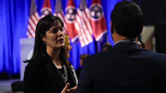 Tennessee commissioner for education Candice McQueen talks with a guest at the Gubernatorial Forum on Education at Belmont University in Nashville, Tenn., Tuesday, Jan. 23, 2018.