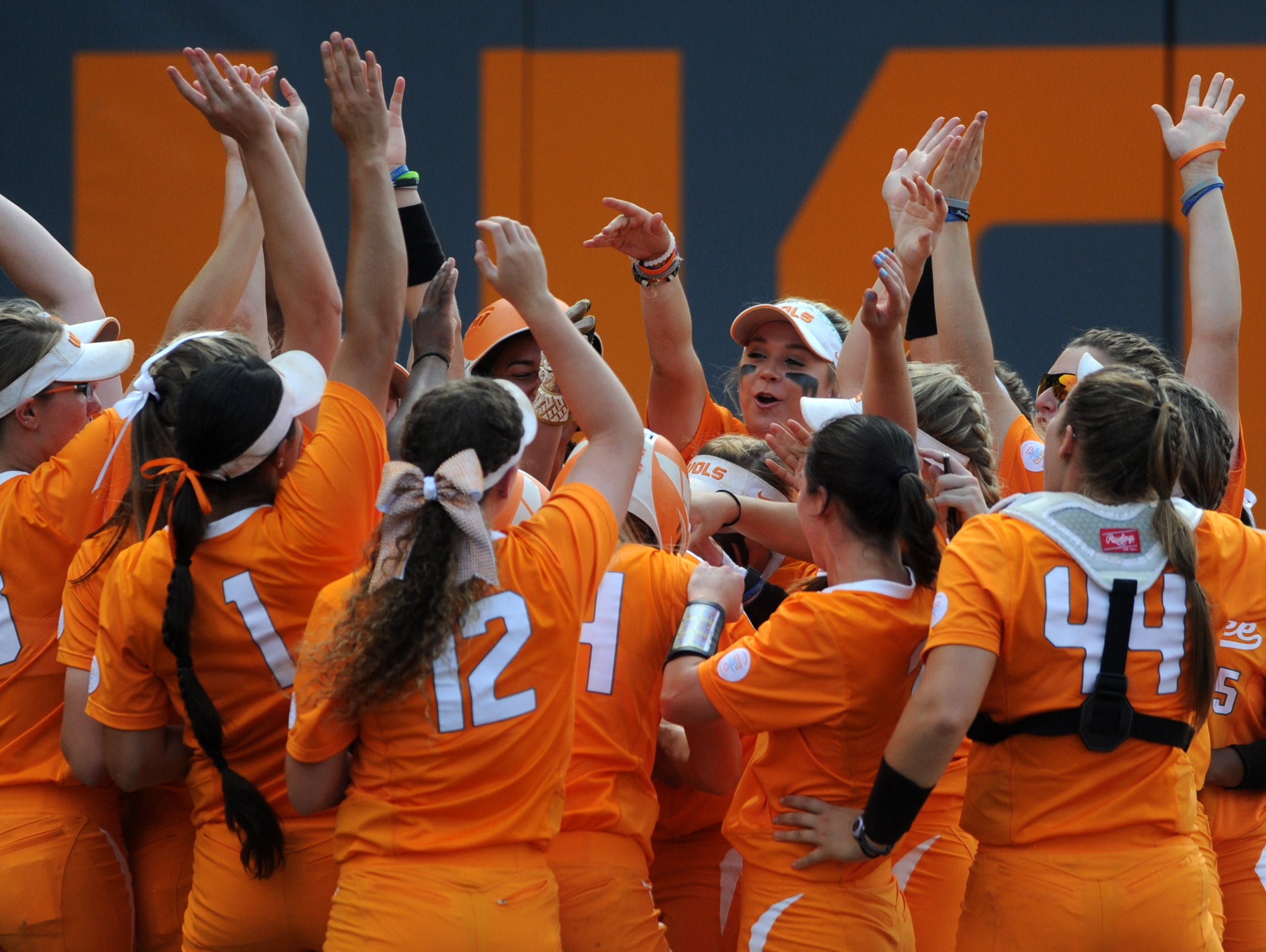 Tennessee players celebrate Tennessee's Meghan Gregg's (55) home run during an NCAA Super Regional game between Tennessee and Texas A&M at Sherri Parker Lee Stadium on Saturday, May 27, 2017.