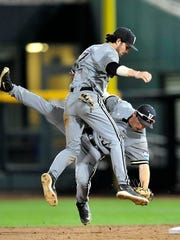 Vanderbilt's Nolan Rodgers, right, collides with Dansby Swanson as he fields the ground ball hit by Virginia during the 8th inning in the Game 2 of the College World Series finals at TD Ameritrade Park, Tuesday, June 23, 2015, in Omaha, Neb.