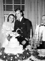 George and Barbara Bush cut the cake at their wedding