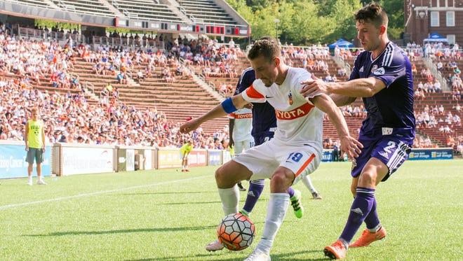 FC Cincinnati's Corben Bone battles for the ball against Louisville City FC last week.