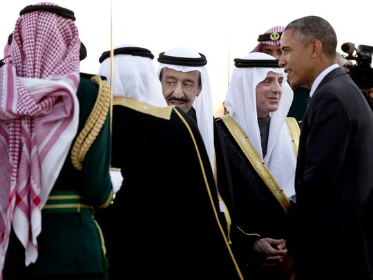 President Obama is greeted by new Saudi King Salman