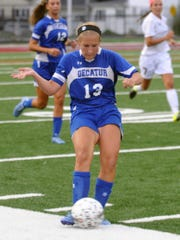 Stephen Decatur senior captain Alexis McDonough passes the ball up the field against Snow Hill on Monday. Wherever and whenever is where McDonough plays for the Seahawks.