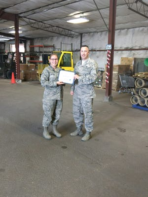 Senior Airman Jordan Martinez, 49th Civil Engineer Squadron operations management journeyman, is presented the Top III Airman award for May from Master Sgt. Timothy Gatten, 54th AMXS first sergeant and Top III president, at Holloman Air Force Base, N.M., June 29, 2017. Martinez's work involved managing four military members and four civilians, overseeing a $2.3 million budget, and eight warehouses containing $17 million worth of materials. On top of filling in as the non-commissioned officer in charge she also filled the chief of material control position. She coordinated 288 purchase request items valued at $525K with 250 vendors driving work production for 11 civil engineer work centers.