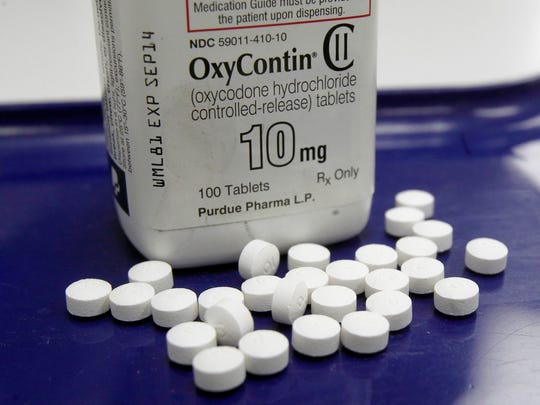 OxyContin pills are arranged at a pharmacy in Montpelier, Vermont, on Feb. 19, 2013.