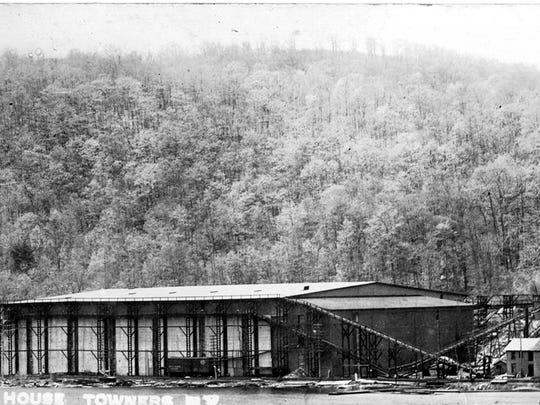 This photo, circa 1900-1920, shows the enormous size of the 3-story ice house, the conveyors, some out-buildings and a refrigerator car sitting on the siding.